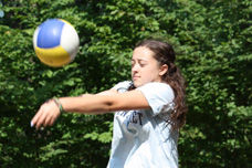 A Girl Playing Volleyball at Adirondack, a Summer Camp for GIrls and Boys