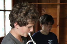 A Boy Playing a Trumpet at Traditional Overnight Camp
