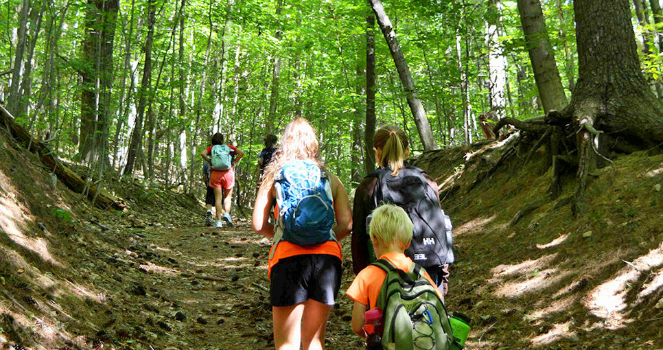 Hiking And Tripping At Overnight Summer Camp For Kids